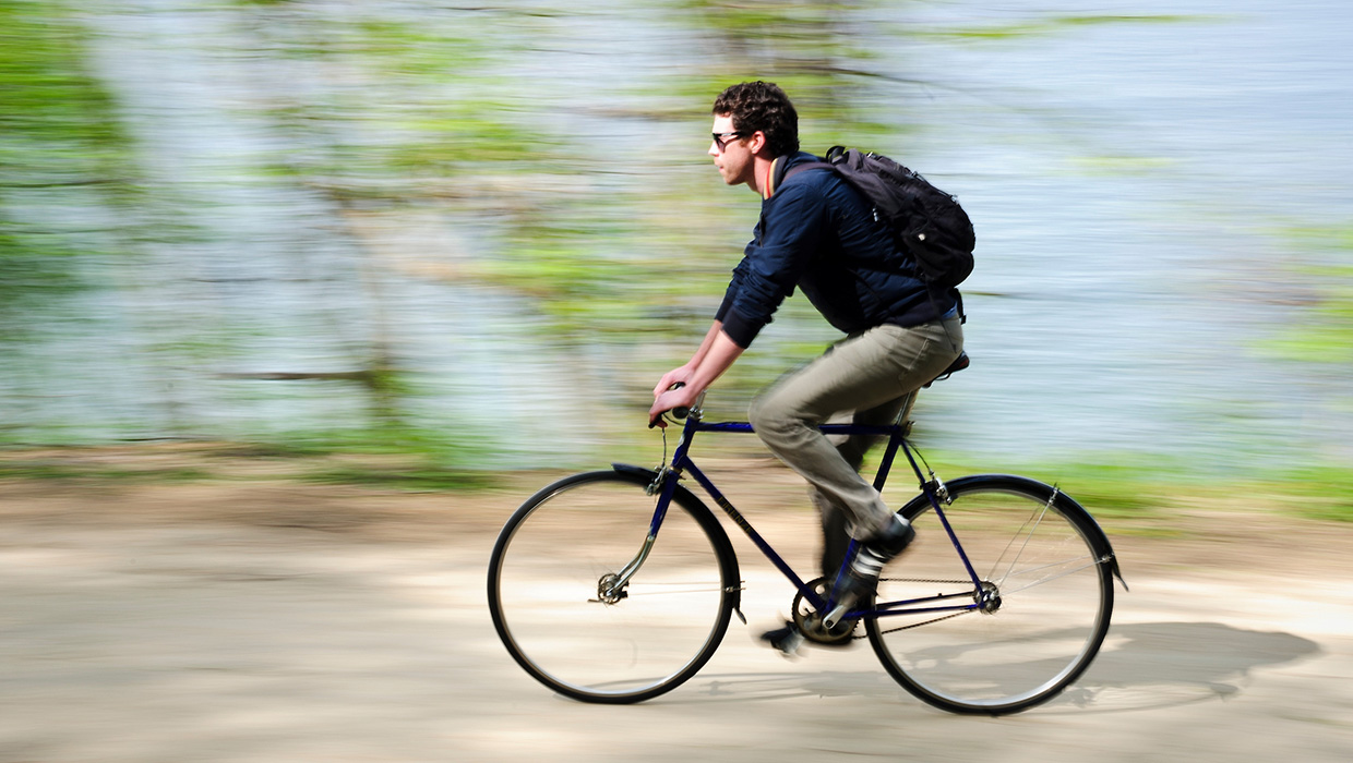 Bicyclist on lakeshore path