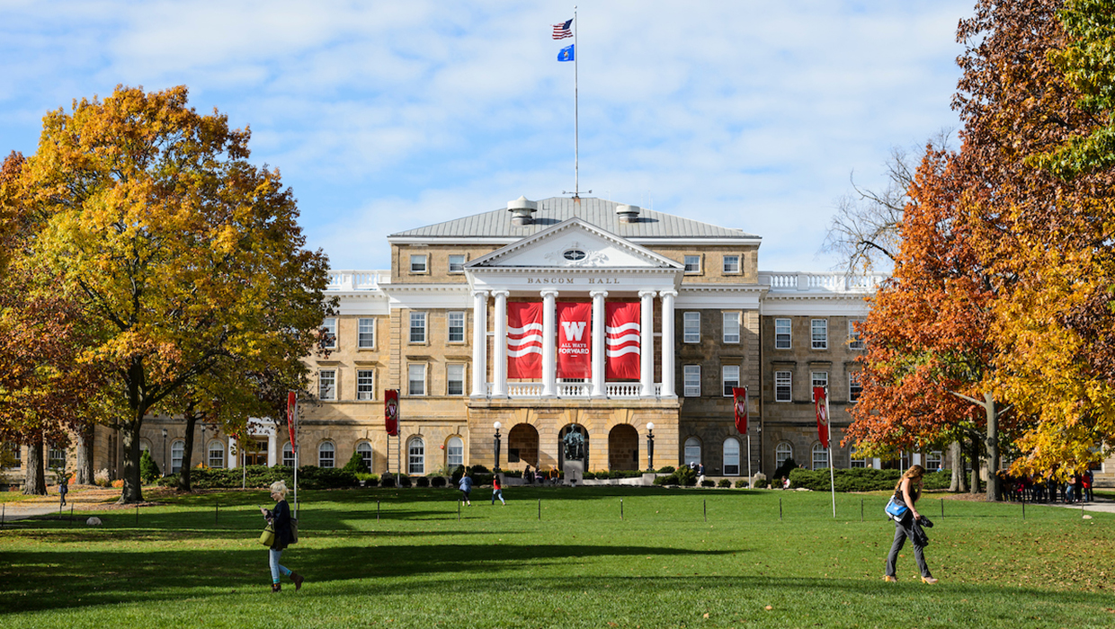 Pedestrians and students walk across Bascom Hill