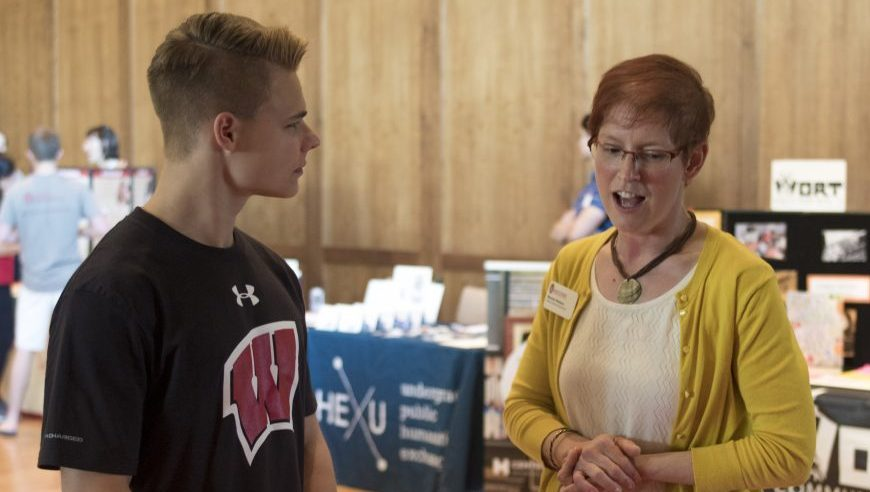 A student talking with a community partner at the Public Service Fair